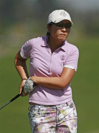PRATTVILLE, AL - OCTOBER 1:  Candie Kung of Taiwan watches her approach shot to the 18th green during first round play in the Navistar LPGA Classic at the Robert Trent Jones Golf Trail at Capitol Hill on October 1, 2009 in  Prattville, Alabama.  (Photo by Dave Martin/Getty Images)