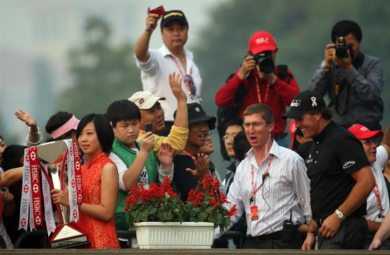 SHANGHAI, CHINA - NOVEMBER 08:  Phil Mickelson of the USA with the winners trophy after the final round of the WGC - HSBC Champions at Sheshan International Golf Club on November 8, 2009 in Shanghai, China.  (Photo by Ross Kinnaird/Getty Images)