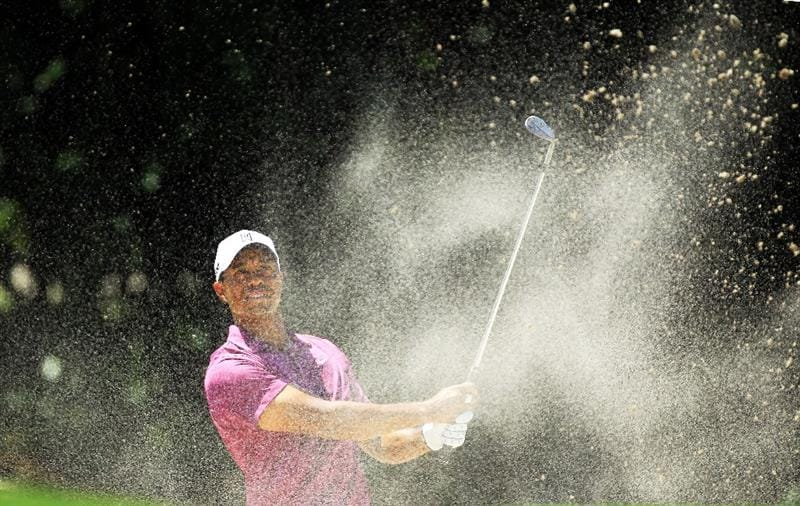 ORLANDO, FL - MARCH 26:  Tiger Woods of the USA explodes from the greenside bunker for his third shot at the 1st hole during the third round of the 2011 Arnold Palmer Invitational presented by Mastercard at the Bay Hill Lodge and Country Club on March 26, 2011 in Orlando, Florida.  (Photo by David Cannon/Getty Images)