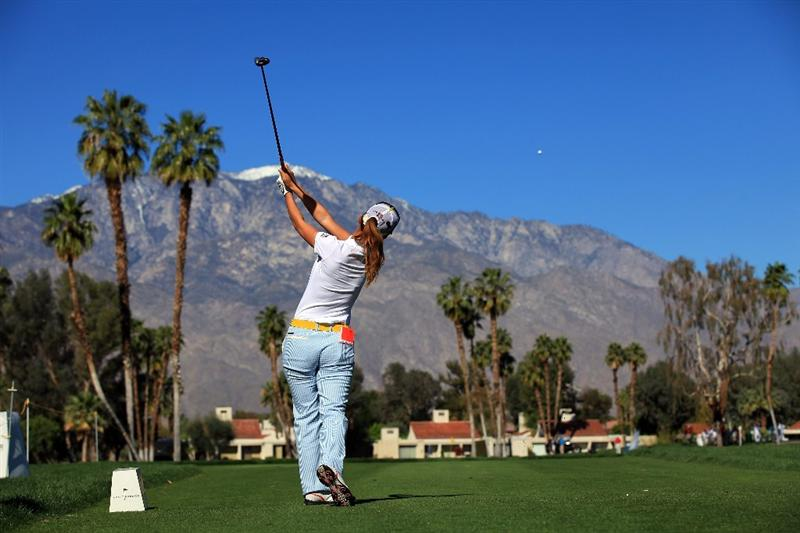 RANCHO MIRAGE, CA - MARCH 31:  Momoko Ueda of Japan plays her tee shot at the par 3, 5th hole during the first round of the 2011 Kraft Nabisco Championship on the Dinah Shore Championship Course at the Mission Hills Country Club on March 31, 2011 in Rancho Mirage, California.  (Photo by David Cannon/Getty Images)