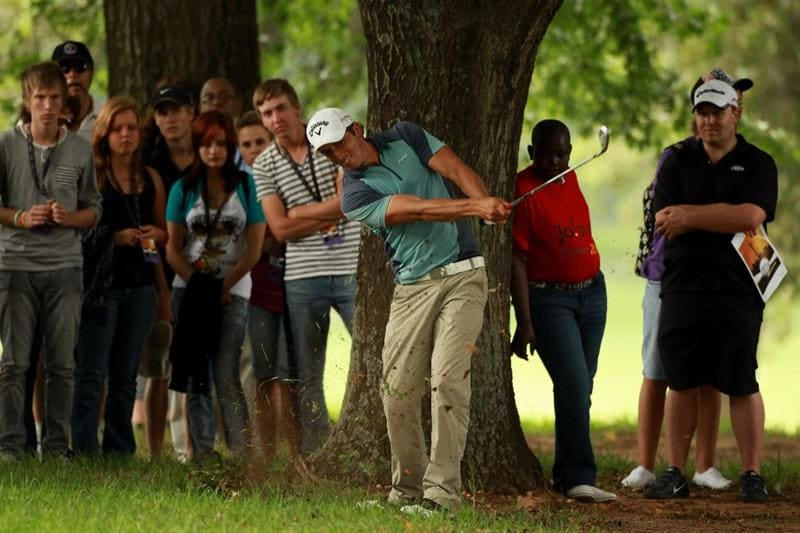 JOHANNESBURG, SOUTH AFRICA - JANUARY 15:  Jamie Elson of England chips out of the trees on the eighth hole during the third round of the Joburg Open at Royal Johannesburg and Kensington Golf Club on January 15, 2011 in Johannesburg, South Africa.  (Photo by Warren Little/Getty Images)