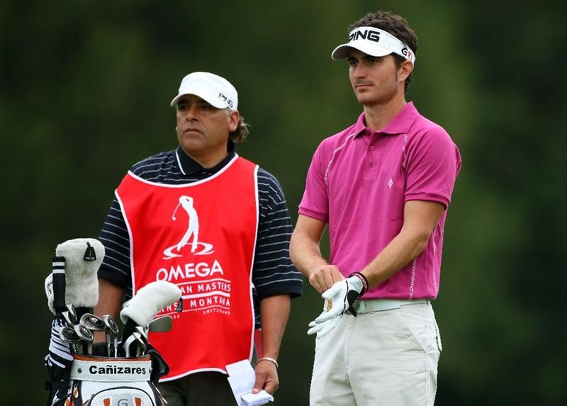 CRANS, SWITZERLAND - SEPTEMBER 06:  Alejandro Canizares of Spain waits with his caddie on the 12th hole during the third round of the Omega European Masters at Crans-Sur-Sierre Golf Club on September 6, 2008 in Crans Montana, Switzerland.  (Photo by Andrew Redington/Getty Images)
