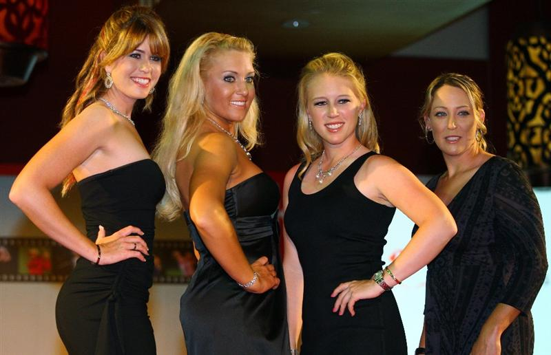 SINGAPORE - MARCH 04:  From left to right:  Paula Creamer, Natalie Gulbis, Morgan Pressel and Cristie Kerr (all of the USA) pose for a photograph during the Gala Dinner prior to the start of the HSBC Women's Champions at Tanah Merah Country Club on March 4, 2009 in Singapore.  (Photo by Andrew Redington/Getty Images)