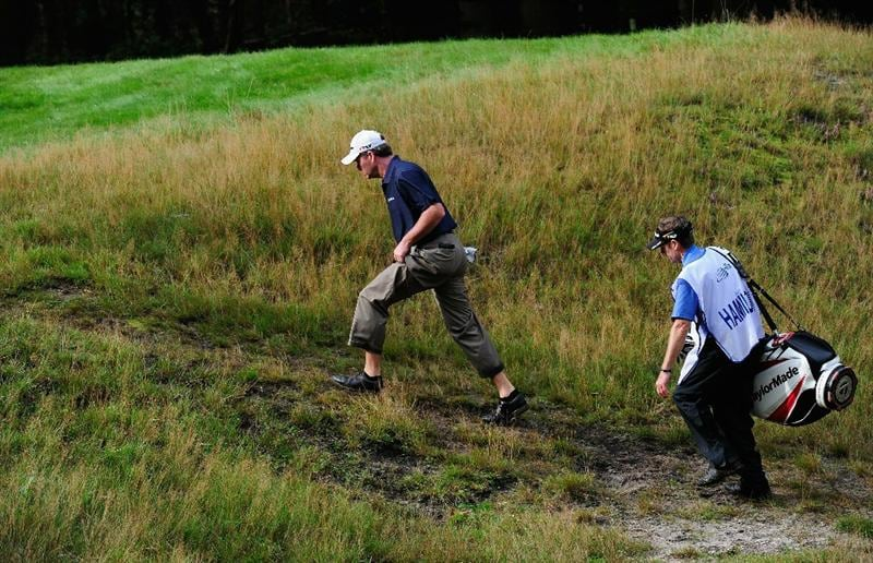 HILVERSUM, NETHERLANDS - SEPTEMBER 10:  Todd Hamilton of USA holds up his trouser legs on the17th hole during the second round of  The KLM Open Golf at The Hillversumsche Golf Club on September 10, 2010 in Hilversum, Netherlands.  (Photo by Stuart Franklin/Getty Images)