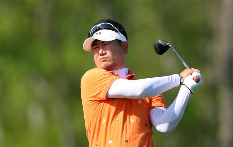 HUMBLE, TX - APRIL 1: Y.E. Yang of South Korea hits his second shot on the 8th hole during the first round of the Shell Houston Open at Redstone Golf Club on April 1, 2010 in Humble, Texas. (Photo by Hunter Martin/Getty Images)