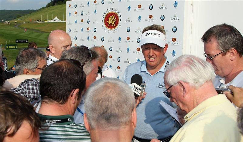 NEWPORT, WALES - JUNE 04:  Colin Montgomerie of Scotland faces the media after completing his second round of the Celtic Manor Wales Open on The Twenty Ten Course at The Celtic Manor Resort on June 4, 2010 in Newport, Wales.  (Photo by Andrew Redington/Getty Images)