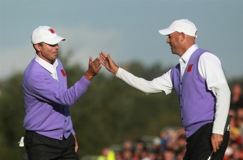 NEWPORT, WALES - OCTOBER 02:  Stewart Cink of the USA (R) celebrates with Matt Kuchar on the 14th green during the rescheduled Morning Fourball Matches during the 2010 Ryder Cup at the Celtic Manor Resort on October 2, 2010 in Newport, Wales.  (Photo by Andrew Redington/Getty Images)