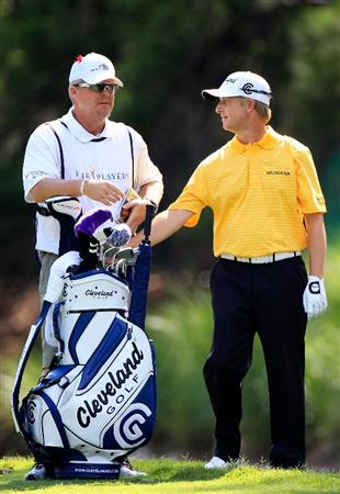 PONTE VEDRA BEACH, FL - MAY 15:  David Toms (R) stands with his caddie D. Scott Gneiser (L) on the tenth hole during the final round of THE PLAYERS Championship held at THE PLAYERS Stadium course at TPC Sawgrass on May 15, 2011 in Ponte Vedra Beach, Florida.  (Photo by Sam Greenwood/Getty Images)