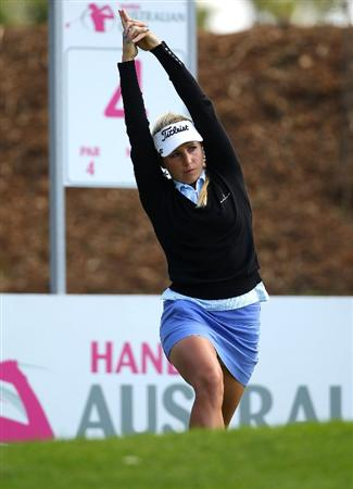 MELBOURNE, AUSTRALIA - MARCH 11:  Danielle Bowers of England stretches before hitting off on the fourth hole during round one of the 2010 Women's Australian Open at The Commonwealth Golf Club on March 11, 2010 in Melbourne, Australia.  (Photo by Mark Dadswell/Getty Images)