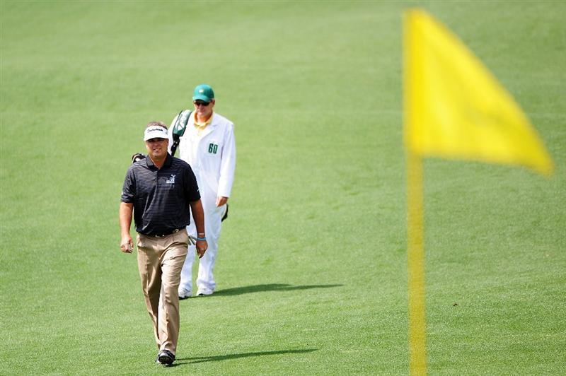 AUGUSTA, GA - APRIL 11:  Kenny Perry walks with his caddie Fred Sanders on the second hole during the third round of the 2009 Masters Tournament at Augusta National Golf Club on April 11, 2009 in Augusta, Georgia.  (Photo by Harry How/Getty Images)