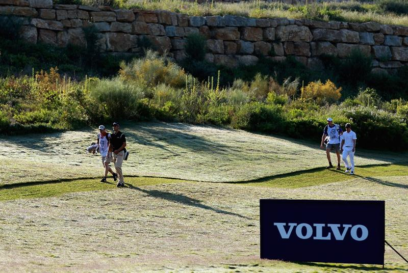 CASARES, SPAIN - MAY 22:  Martin Kaymer of Germany (left) and Luke Donald of England walk with their caddies during the semi final of the Volvo World Match Play Championship at Finca Cortesin on May 22, 2011 in Casares, Spain.  (Photo by Andrew Redington/Getty Images)