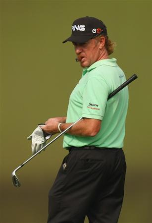 SHENZHEN, CHINA - NOVEMBER 26:  Miguel Angel Jimenez of Spain looks on during the Pro - Am of the Omega Mission Hills World Cup at the Mission Hills Resort on November 26, 2008 in Shenzhen, China.  (Photo by Ian Walton/Getty Images)