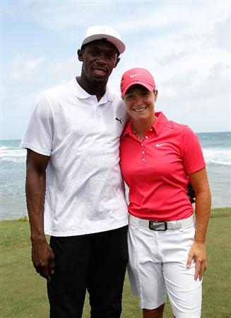 MONTEGO BAY, JAMAICA - APRIL 16:  Usain Bolt and Suzann Pettersen of Norway pose for a photo during the semifinal matches of The Mojo 6 Jamaica LPGA Invitational at Cinnamon Hill Golf Course on April 16, 2010 in Montego Bay, Jamaica.  (Photo by Kevin C. Cox/Getty Images)