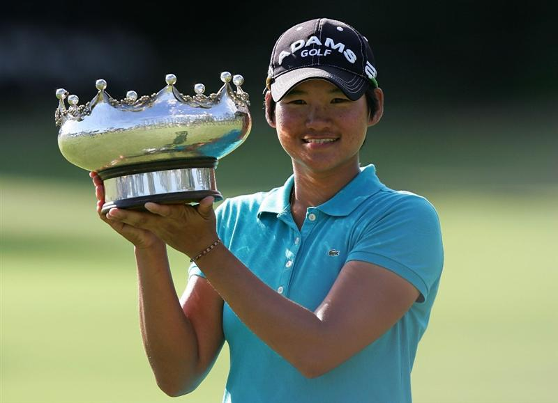 MELBOURNE, AUSTRALIA - MARCH 14:  Yani Tseng of Chinese Tapai poses with the trophy after winning the 2010 Women's Australian Open at The Commonwealth Golf Club on March 14, 2010 in Melbourne, Australia.  (Photo by Scott Barbour/Getty Images)