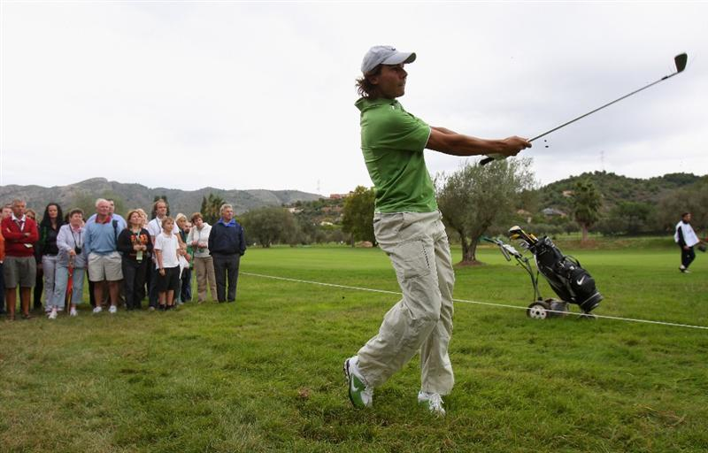 CASTELLO, SPAIN - OCTOBER 22:  World number one tennis player Rafael Nadal of Spain plays a shot during the pro - am of the Castello Masters Costa Azahar at the Club de Campo del Mediterraneo on October 22, 2008 in Castello, Spain.  (Photo by Stuart Franklin/Getty Images)