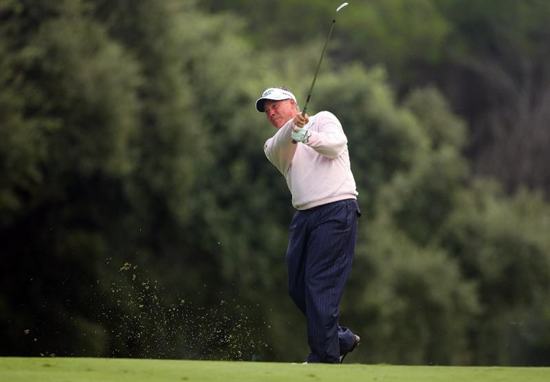 SOTOGRANDE, SPAIN - NOVEMBER 02:  Darren Clarke of Northern Ireland plays his second shot on the 16th hole during the third round of the Volvo Masters at Valderrama Golf Club on November 2, 2008 in Sotogrande, Spain.  (Photo by Andrew Redington/Getty Images)