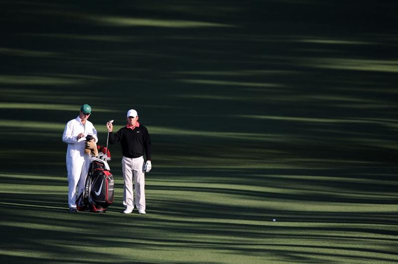AUGUSTA, GA - APRIL 09:  Justin Leonard (R) pulls a club alongside caddie Brian Smith on the second fairway during the second round of the 2010 Masters Tournament at Augusta National Golf Club on April 9, 2010 in Augusta, Georgia.  (Photo by Harry How/Getty Images)