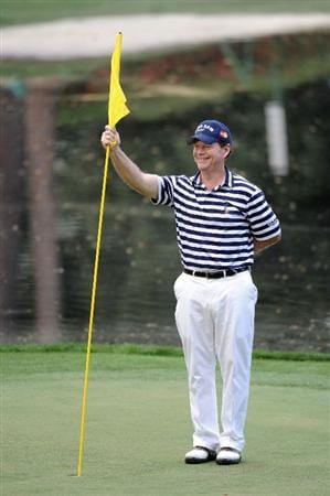 AUGUSTA, GA - APRIL 07:  Tom Watson holds the flag during the Par 3 Contest prior to the 2010 Masters Tournament at Augusta National Golf Club on April 7, 2010 in Augusta, Georgia.  (Photo by Harry How/Getty Images)