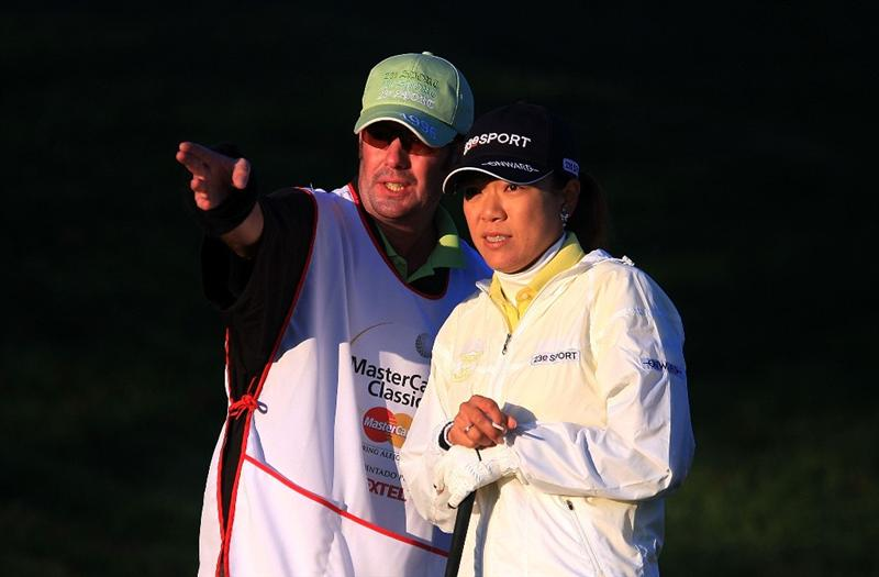 HUIXQUILUCAN, MEXICO - MARCH 20:  Shiho Oyama of Japan chats with her caddie on the 10th hole during the first round of the MasterCard Classic at the BosqueReal Country Club on March 20, 2009 in Huixquiucan, Mexico.  (Photo by Scott Halleran/Getty Images)