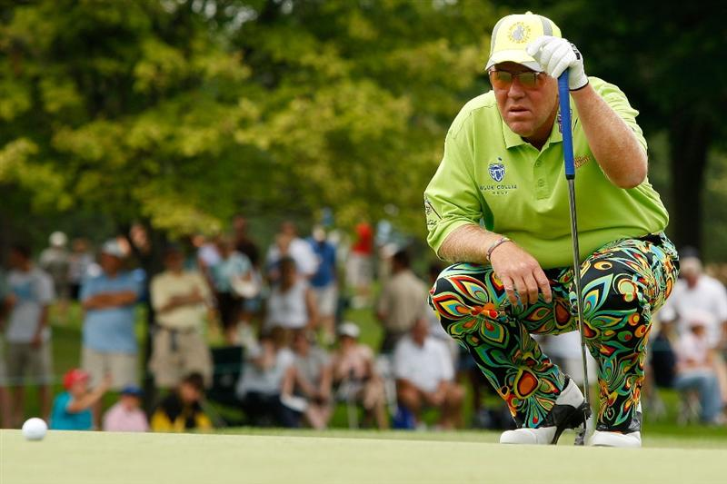 GRAND BLANC, MI - JULY 30:  John Daly lines up a putt for birdie on the first hole during round one of the Buick Open at Warwick Hills Golf and Country Club on July 30, 2009 in Grand Blanc, Michigan.  (Photo by Chris Graythen/Getty Images)
