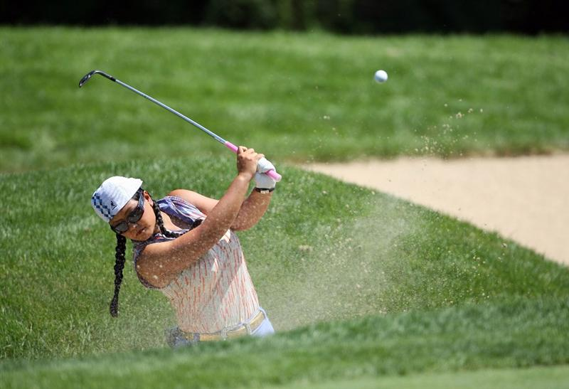 HAVRE DE GRACE, MD - JUNE 12:  Christina Kim hits her third shot on the 13th hole during the second round of the McDonald's LPGA Championship at Bulle Rock Golf Course on June 12, 2009 in Havre de Grace, Maryland.  (Photo by Andy Lyons/Getty Images)