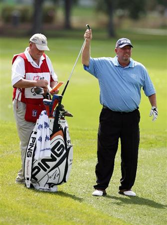 PALM BEACH GARDENS, FL - MARCH 08:  Mark Calcavecchia selects a club to hit his approach on the sixth hole during the final round of The Honda Classic at PGA National Resort and Spa on March 8, 2009 in Palm Beach Gardens, Florida.  (Photo by Doug Benc/Getty Images)