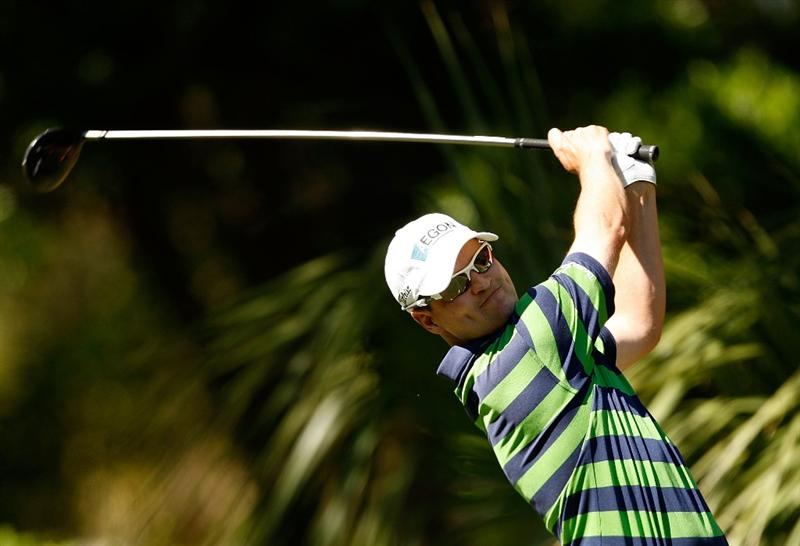 HILTON HEAD ISLAND, SC - APRIL 17:  Zach Johnson hits his tee shot on the 11th hole during the second round of the Verizon Heritage at Harbour Town Golf Links on April 17, 2009 in Hilton Head Island, South Carolina.  (Photo by Streeter Lecka/Getty Images)