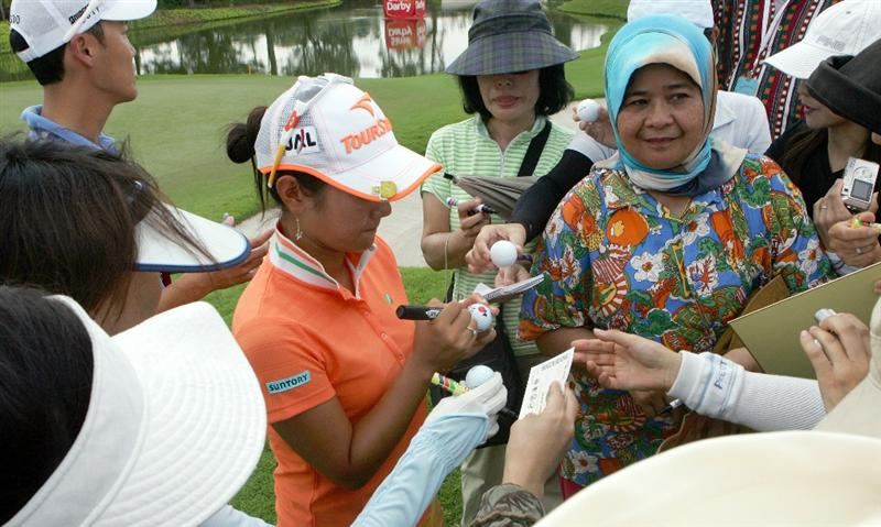 KUALA LUMPUR, MALAYSIA - OCTOBER 21:   Al Miyazato of Japan signs autographs for the fans during the Sime Darby Pro-Am at the KLGCC Golf Course on October 21, 2010 in Kuala Lumpur, Malaysia (Photo by Stanley Chou/Getty Images)