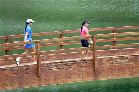 ROGERS, AR - JULY 5:  Jeong Jang (R) of South Korea and Nicole Castrale walk across a bridge to the 15th green during the second round of the P&G Beauty NW Arkansas Championship presented by John Q. Hammons on July 5, 2008 at Pinnacle Country Club in Rogers, Arkansas. (Photo by G. Newman Lowrance/Getty Images)