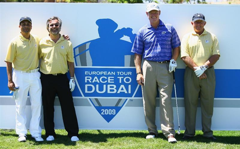 PAARL, SOUTH AFRICA - DECEMBER 17:  Ernie Els of South Africa poses with his Jumeirah Golf Estate playing partners against the European Tour's Race to Dubai board during the pro-am of the South African Open Championship at Pearl Valley Golf Club on December 17, 2008 in Paarl, South Africa.  (Photo by Warren Little/Getty Images)