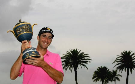 MIAMI - MARCH 24:  Geoff Ogilvy of Australia poses with the trophy after winning the 2008 World Golf Championships CA Championship on a score of 17 under par at the Doral Golf Resort & Spa, on March 24, 2008 in Miami, Florida.  (Photo by Warren Little/Getty Images)