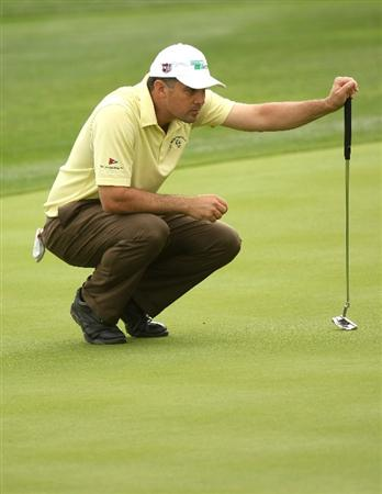 LA QUINTA, CA - JANUARY 23:  Brad Adamonis lines up his putt on the 15th hole at the SilverRock Resort during the third round of the Bob Hope Chrysler Classic on January 23, 2009 in La Quinta, California.  (Photo by Stephen Dunn/Getty Images)