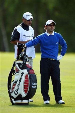 WENTWORTH, ENGLAND - MAY 22:  Fabrizio Zanotti of Paraguay prepares to hit his second shot on the 9th  hole assisted by his caddie during the Second Round of the BMW PGA Championship at Wentworth on May 22, 2009 in Virginia Water, England.  (Photo by Ian Walton/Getty Images)