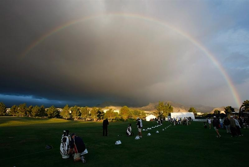 LAS VEGAS - OCTOBER 14:  A rainbow appears over players warming up on the driving range before the start of play at the Justin Timberlake Shriners Hospitals for Children Open Championship Pro-Am at the TPC Summerlin October 14, 2009 in Las Vegas, Nevada.  (Photo by Ethan Miller/Getty Images)