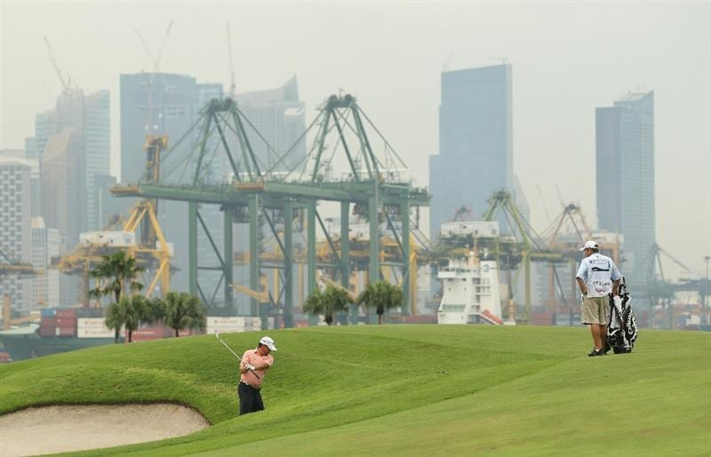 SINGAPORE - NOVEMBER 13:  Graeme McDowell of Northern Ireland in action during the Final Round of the Barclays Singapore Open at Sentosa Golf Club on November 14, 2010 in Singapore, Singapore.  (Photo by Ian Walton/Getty Images)