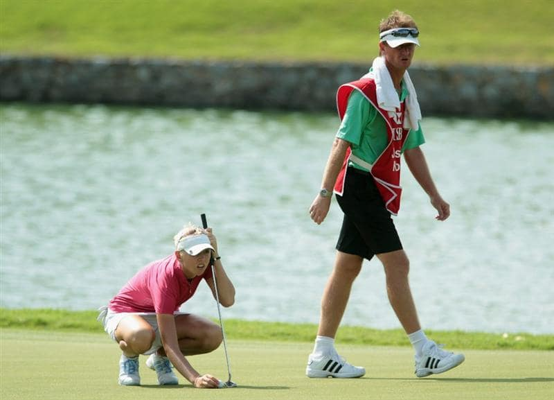 SINGAPORE - FEBRUARY 27:  Jessica Korda of the USA lines up a putt on the eighth green as her father/caddie Petr looks on during the final round of the HSBC Women's Champions 2011 at the Tanah Merah Country Club on February 27, 2011 in Singapore, Singapore.  (Photo by Scott Halleran/Getty Images)