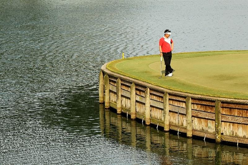 PONTE VEDRA BEACH, FL - MAY 13:  Y.E. Yang of South Korea looks on from the 17th green during the second round of THE PLAYERS Championship held at THE PLAYERS Stadium course at TPC Sawgrass on May 13, 2011 in Ponte Vedra Beach, Florida.  (Photo by Mike Ehrmann/Getty Images)