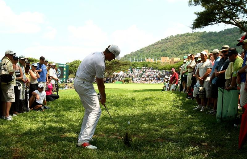 SUN CITY, SOUTH AFRICA - DECEMBER 07:  Robert Karlsson of Sweden plays his 3rd shot into the 9th green from a spectator walkway during the final round of the Nedbank Golf Challenge at the Gary Player Country Club on December 7, 2008 in Sun City, South Africa.  (Photo by Richard Heathcote/Getty Images)