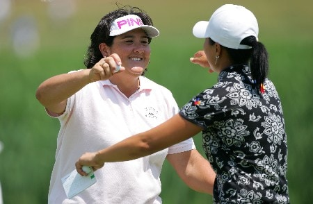 HAVRE DE GRACE, MD - JUNE 07:  Pat Hurst and Se Ri Pak of South Korea embrace after the first round of the McDonalds LPGA Championship at Bulle Rock golf course June 7, 2007 in Havre de Grace, Maryland. In completing the round today, Pak qualifies for the LPGA Tour and World Golf halls of fame.  (Photo by Andy Lyons/Getty Images)