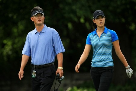EDINA, MN - JUNE 25:  Michelle Wie (R) walks with her father B.J. Wie during a practice round prior to the 2008 U.S. Women's Open at Interlachen Country Club on June 25, 2008 in Edina, Minnesota.  (Photo by Travis Lindquist/Getty Images)