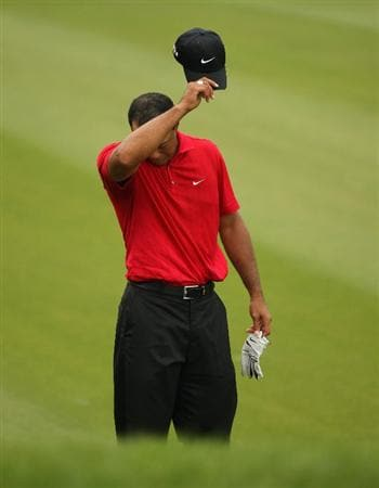 SHANGHAI, CHINA - NOVEMBER 08:  Tiger Woods of the USA looks despondent on the seventh hole during the final round of the WGC - HSBC Champions at Sheshan International Golf Club on November 8, 2009 in Shanghai, China.  (Photo by Ross Kinnaird/Getty Images)
