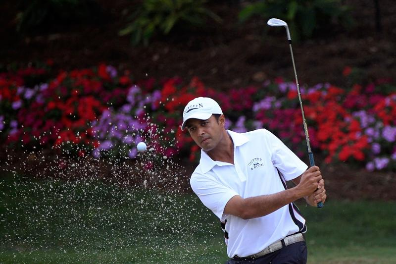 PONTE VEDRA BEACH, FL - MAY 11:  Arjun Atwal of India hits from a bunker during a practice round prior to the start of THE PLAYERS Championship held at THE PLAYERS Stadium course at TPC Sawgrass on May 11, 2011 in Ponte Vedra Beach, Florida.  (Photo by Sam Greenwood/Getty Images)