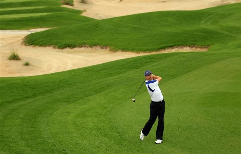BAHRAIN, BAHRAIN - JANUARY 28:  Padraig Harrington of Ireland plays his second shot on the 14th hole during the second round of the Volvo Golf Champions at The Royal Golf Club on January 28, 2011 in Bahrain, Bahrain.  (Photo by Andrew Redington/Getty Images)
