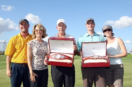 CHAMPIONS GATE, FLORIDA - DECEMBER 02:  Larry Nelson (L) with his son Josh Nelson with their trophies and family members after they had won the 2007 Del Webb Father Son Challenge on the International Course at Champions Gate Golf Club, on December 2, 2007 in Champions Gate, Florida,  (Photo by David Cannon/Getty Images)
