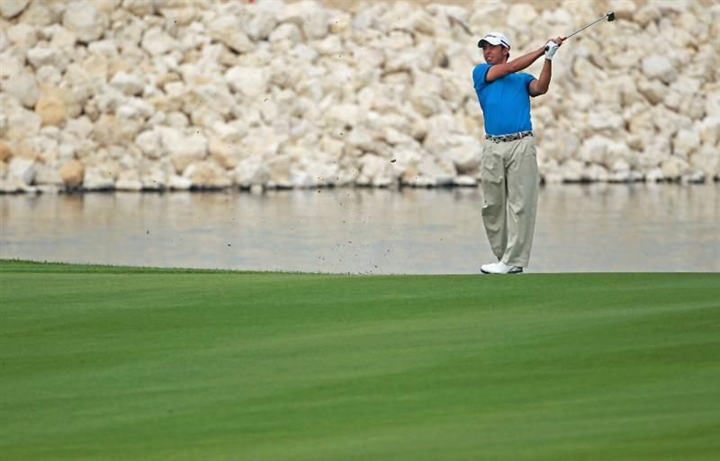 BAHRAIN, BAHRAIN - JANUARY 27:  Pablo Larrazabal of Spain hits his second shot on the 18th hole during the first round of the Volvo Golf Champions at The Royal Golf Club on January 27, 2011 in Bahrain, Bahrain.  (Photo by Andrew Redington/Getty Images)