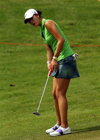 KUALA LUMPUR, MALAYSIA - OCTOBER 21:  Michelle Wie of USA watches her putting shot on the 8th hole during the Sime Darby Pro-Am at the KLGCC Golf Course on October 21, 2010 in Kuala Lumpur, Malaysia.  (Photo by Stanley Chou/Getty Images)