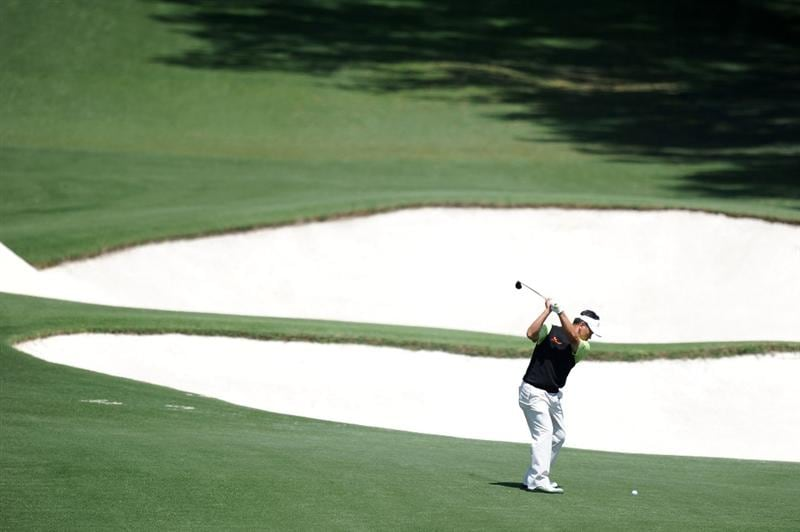 AUGUSTA, GA - APRIL 09:  K.J. Choi of Korea hits his second shot on the eigth hole during the second round of the 2010 Masters Tournament at Augusta National Golf Club on April 9, 2010 in Augusta, Georgia.  (Photo by Harry How/Getty Images)