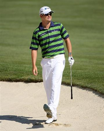 DUBLIN, OH - JUNE 05:  Zach Johnson hits his second shot on the 18th hole during the second round of the Memorial Tournament on June 5, 2009 at the Muirfield Village Golf Club in Dublin, Ohio.  (Photo by Andy Lyons/Getty Images)