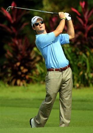 KUALA LUMPUR, MALAYSIA - OCTOBER 29: Heath Slocum of USA watches his 2nd shot on the 1st hole during day two of the CIMB Asia Pacific Classic at The MINES Resort & Golf Club on October 29, 2010 in Kuala Lumpur, Malaysia.  (Photo by Stanley Chou/Getty Images)