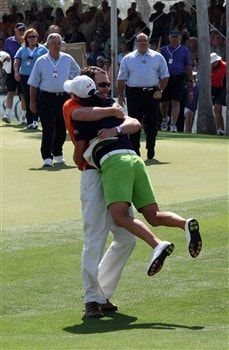 RANCHO MIRAGE, CA - APRIL 06:  Lorena Ochoa of Mexico is embraced by her brother Alejandro on the green at the 18th hole during the final round of the Kraft Nabisco Championship at the Mission Hills Country Club, on April 6, 2008 in Rancho Mirage, California.  (Photo by David Cannon/Getty Images)